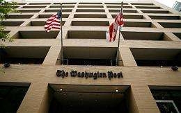The Washington Post Co. reversed its slide and posted a quarterly profit despite a steep decline in advertising revenue