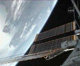 Space station's new solar wings open easily (AP)