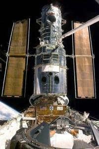 Hubble Space Telescope resting in the Space Shuttle Discovery?s cargo bay, in 1999