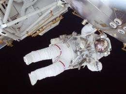 A flight engineer participates as construction and maintenance continue on the International Space Station