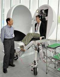 """A Japanese professor presents his virtual reality machine """"Media Vehicle"""" at the expo in Tokyo"""