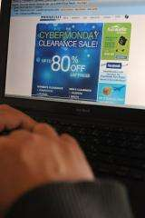 A man looks at a Cyber Monday advertisement on his laptop computer