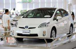 """A man looks at the third-generation """"Prius"""" of Japanese auto giant Toyota Motor at a showroom in Tokyo"""