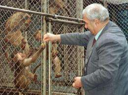 An undated photo shows then director of Sukhumi's monkey nursery, Sergei Ardzimba, feeding his monkeys