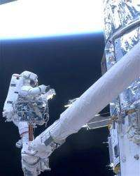 Astronauts say goodbye to Hubble for good (AP)