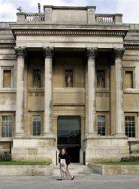 A woman walks by the Sir Paul Getty enterance to the National Gallery in London
