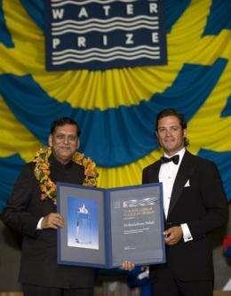 Bindeshwar Pathak (left), receives the Stockholm Water prize from Swedish Prince Carl Philip