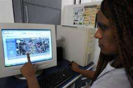"""Brazilian Alini dos Santos Silva, 28, points at the map of the three """"favelas"""" she and a team of neighbours designed"""