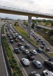 Cars sit in traffic on a highway