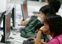 Chinese people surfing the internet in Beijing