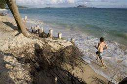 Hawaii's famed white sandy beaches are shrinking (AP)