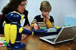 Kevin Fitzgerald (R) and his therapist Carole Samango-Sprousse use the robot Cosmo