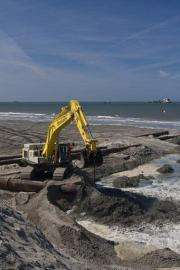 More than 18 million cubic metres of sand are set to be poured onto the new coastal band of dunes until 2011
