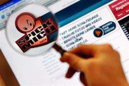 """Picture shows a student viewing the logo of the German website """"spick.mich"""" in Berlin"""