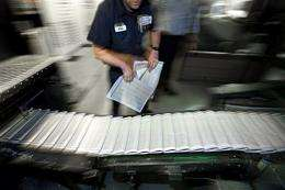 Pressmen check the final editions of the Rocky Mountain News starting to roll off the presses in February