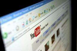 US media and entertainment giant Time Warner and YouTube announced an agreement Wednesday to show clips