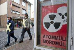 """Anti-nuclear prosters in Dannenberg, Germany, today pass a sign saying: """"Nuclear waste is murder waste"""""""
