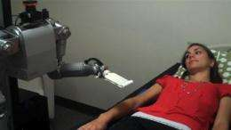 How do people respond to being touched by a robot?