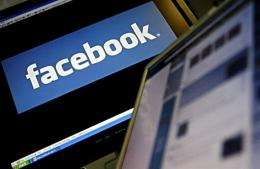 The logo of social networking website 'Facebook' is displayed on a computer screen
