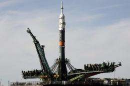 A Soyuz rocket spacecraft is positioned on the launch pad at the Baikonur cosmodrome,