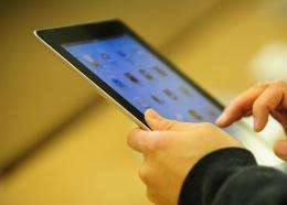 Customers try the iPad 2 at an Apple store
