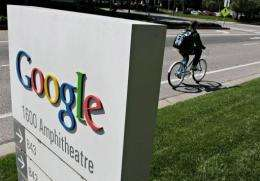 A bicyclist rides by Google headquarters in Mountain View, California