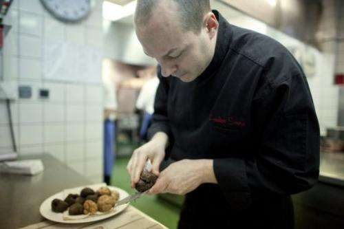 A French chef prepares truffles in his kitchen