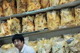 A man inside a shark fin store in Hong Kong