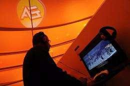 A man plays a computer game