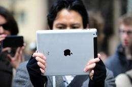 A man test the latest iPad 2