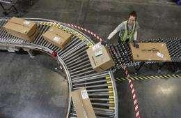 Amazon.com's profit tumbles more than expected (AP)