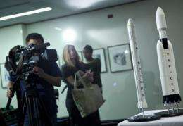 A model of SpaceX's Falcon Heavy rocket is shown to the media