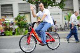 A New York resident goes for a spin during a demonstration of a new bicycle sharing system which will start next year