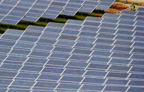 A technician inspects newly installed solar panels