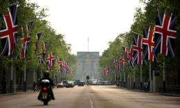 British Union Jack flags fly on the Mall leading to Buckingham Palace ahead of the royal wedding