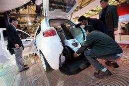 China's electric car tactics rattle automakers (AP)