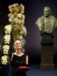Claudia Steinman (L) gestures after receiving her late husband Canadian Ralph Steinman's 2011 Nobel Prize in Medicine