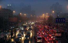 Evening rush hour traffic comes to a standstill on a hazy and polluted day in Beijing in 2010