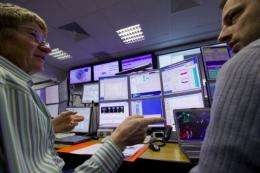 Experiments at the world's biggest atom smasher have yielded hints that a long-sought sub-atomic particle truly exists