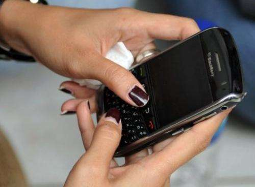 Experts point to problems among smartphone and tablet users arising from hours spent leaning over tiny screens.