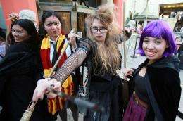 """Fans pose during the opening night of """"Harry Potter and the Deathly Hallows: Part II"""" at Grauman's Chinese Theatre"""