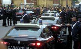 Italian police cars wait to take suspects from their headquarters in Palermo in 2008