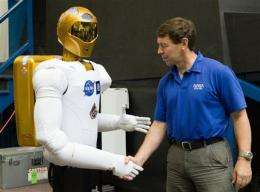 It's alive! Space station's humanoid robot awake (AP)