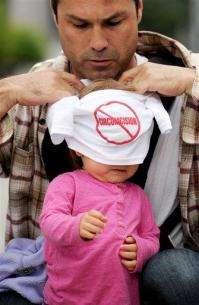 Judge orders circumcision ban off SF ballot (AP)