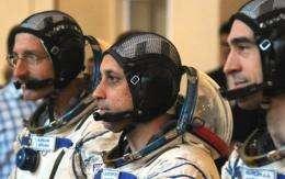 (L-R) US astronaut Dan Burbank together with Russian cosmonauts Anton Shkaplerov and Anatoly Ivanishin