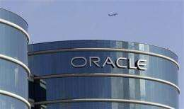 Oracle's profit tops Street, but worries surface (AP)