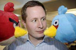 """Rovio CEO Mikael Hed poses with two """"Angry Birds"""""""