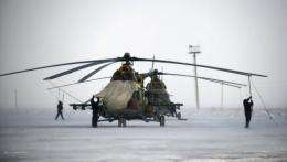 Search-and-rescue specialists prepare for the arrival of Russian Soyuz TMA-01M spacecraft, in Kazakhstan