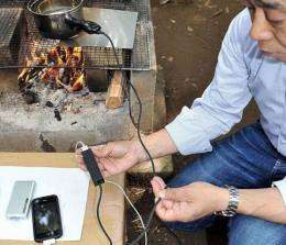 TES NewEnergy unveils a pot that can charge mobile phones while boiling water for use in other emergency situations