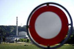 The Muehleberg nuclear power plant is seen behind a road sign in Muehleberg